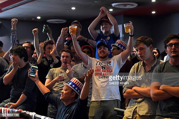 Supporters of US Republican candidate Donald Trump celebrate as they watch results at the United States Studies Center at the University of Sydney on...