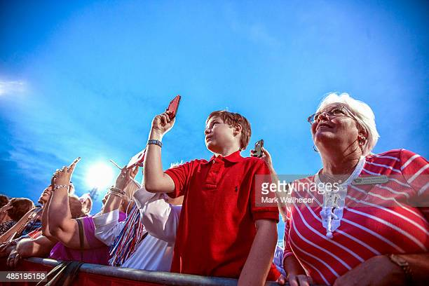 Supporters of US Republican presidential candidate Donald Trump listen during his rally at LaddPeebles Stadium on August 21 2015 in Mobile Alabama...