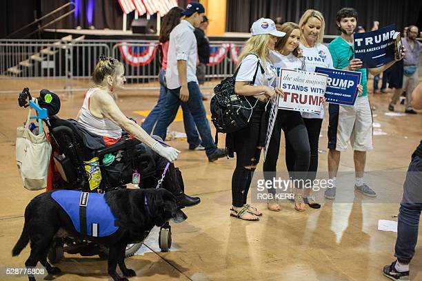 Supporters of US Republican presidential candidate Donald Trump take photos after a rally in Eugene Oregon on May 6 2016 / AFP / Rob Kerr