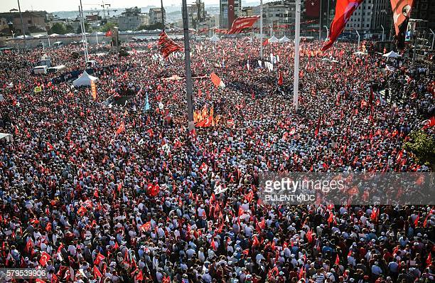 TOPSHOT Supporters of various political parties shout slogans and hold Turkish flags and pictures of Ataturk founder of modern Turkey in Istanbul's...