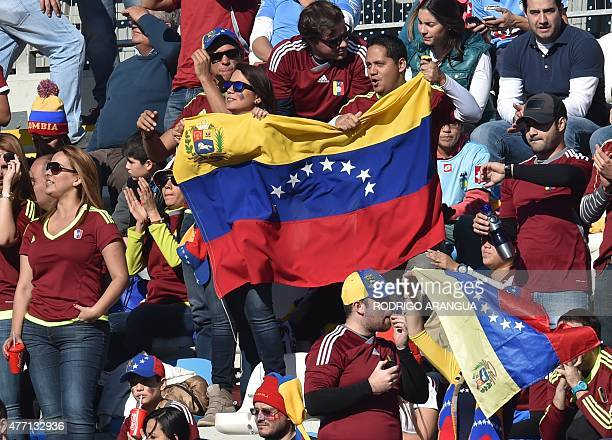 Supporters of Venezuela wait for the start of the 2015 Copa America football championship match against Colombia in Rancagua Chile on June 14 2015...
