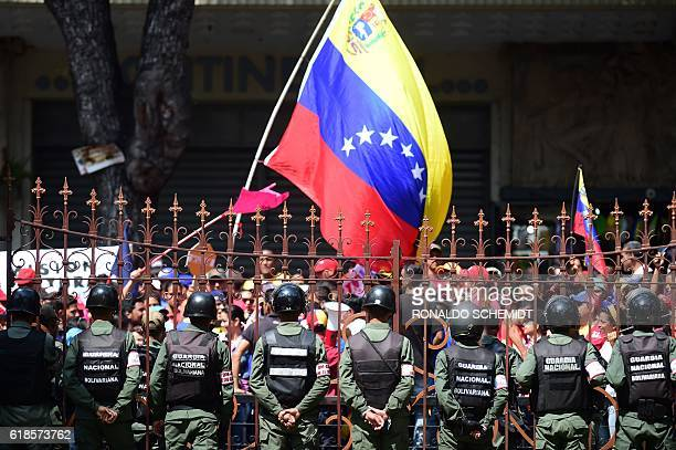 TOPSHOT Supporters of Venezuelan government gather before the National Assembly in Caracas on October 27 2016 Venezuela's opposition ratchets up the...