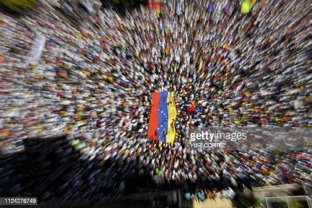 TOPSHOT Supporters of Venezuelan opposition leader and self declared acting president Juan Guaido take part in rally to press the military to let in...