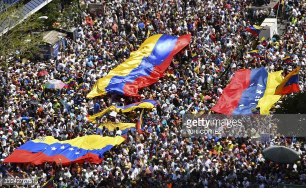 Supporters of Venezuelan opposition leader and self declared acting president Juan Guaido take part in rally to press the military to let in US...