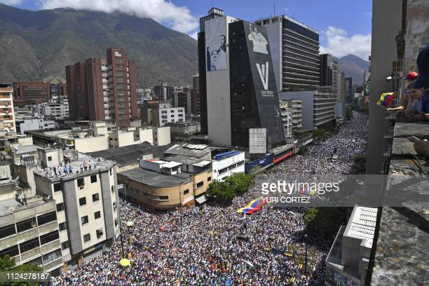 Supporters of Venezuelan opposition leader and self declared acting president Juan Guaido take part in a rally to press the military to let in US...