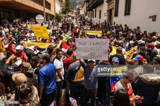 Supporters of Venezuelan opposition leader and selfdeclared acting president Juan Guaido demonstrate outside Colombia's Foreign Ministry in Bogota...