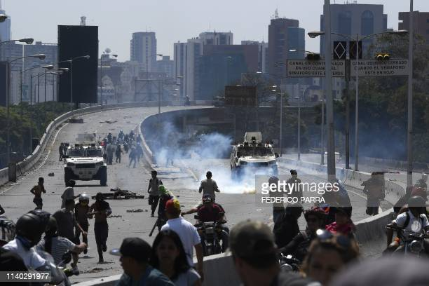 Supporters of Venezuelan opposition leader and selfproclaimed acting president Juan Guaido clash with forces loyal to President Nicolas Maduro after...