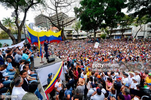 Supporters of Venezuelan opposition leader and selfproclaimed interim president Juan Guaido take part in a meeting at Chacao neighbourhood in Caracas...