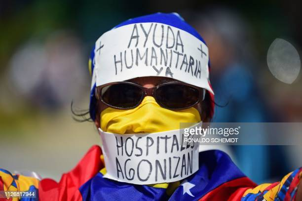 TOPSHOT Supporters of Venezuelan opposition leader Juan Guaido wait to take part in a rally in Caracas on February 23 2019 Venezuela braced for a...