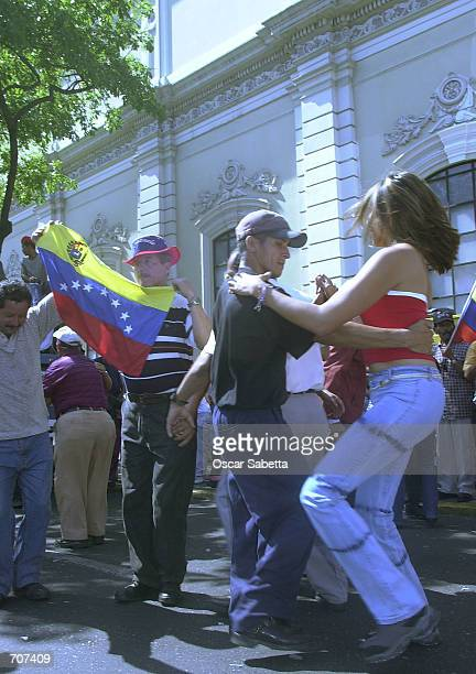 Supporters of Venezuelan President Hugo Chavez celebrate by dancing the national dance known as Joropo in front of Miraflores presidential palace...