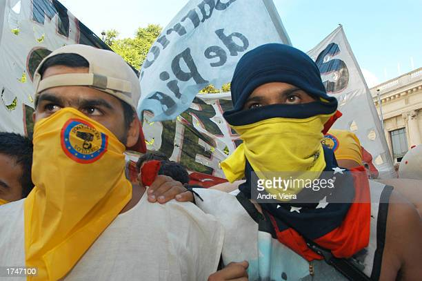 Supporters of Venezuelan President Hugo Chavez demonstrate outside the city parliament January 27 2003 Porto Alegre Brazil Representatives from the...