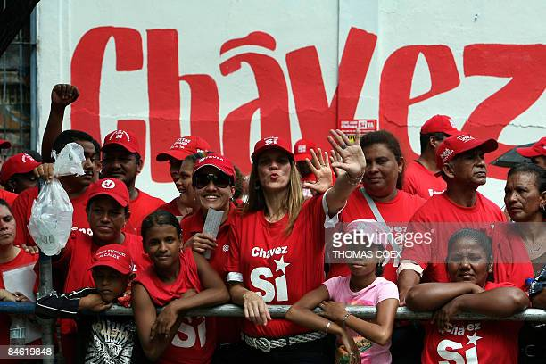 Supporters of Venezuelan President Hugo Chavez wait behind a barrier during a visit to the city of Cumana state of Sucre 275 km east of Caracas on...
