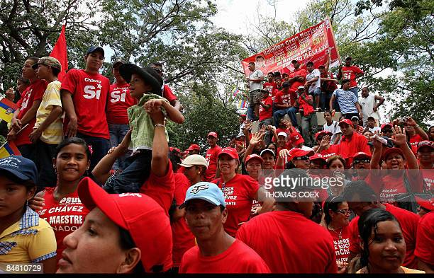 Supporters of Venezuelan President Hugo Chavez wait during a visit to the city of Cumana state of Sucre 275 km east of Caracas on February 3 2009...