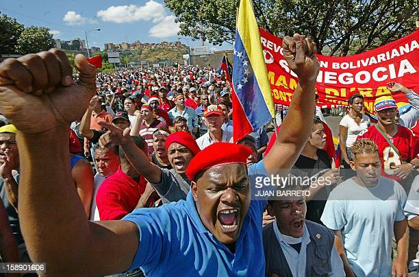 Supporters of Venezuelan President Hugo Chávez rally for a march in Caracas 03 January 2003 as an opposition march headed for the Fuerte Tiuna...
