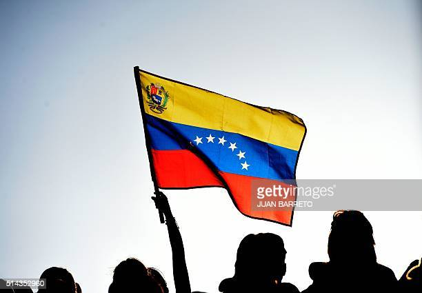 Supporters of Venezuelan President Nicolas Maduro attend a rally at Miraflores presidential palace in Caracas on March 8 2016 Venezuela's opposition...