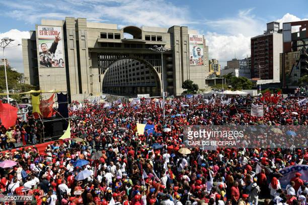Supporters of Venezuelan President Nicolas Maduro attend a rally at Diego Ibarra square in Caracas after Maduro submitted his presidential...