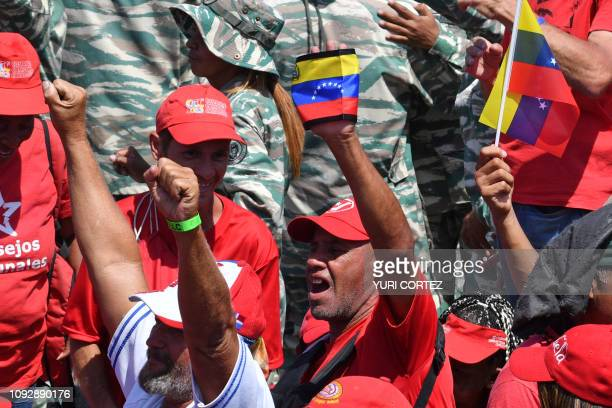 Supporters of Venezuelan President Nicolas Maduro cheer as they gather to mark the 20th anniversary of the rise of power of the late Hugo Chavez the...