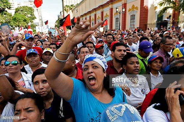Supporters of Venezuelan President Nicolas Maduro gather outside the Miraflores presidential palace in Caracas on December 15 2015 The progovernment...