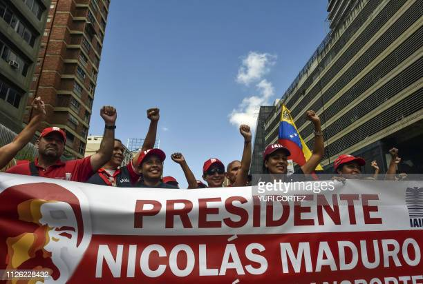 Supporters of Venezuelan President Nicolas Maduro raise their fists while shouting slogans during an 'antiimperialist day' in support of his...