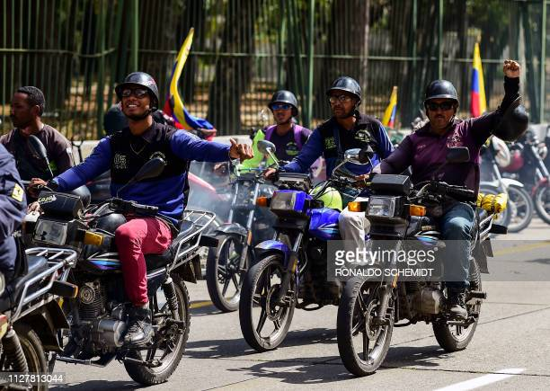 Supporters of Venezuelan President Nicolas Maduro ride their motorcycles during a demonstration in Caracas on February 27 2019 Venezuela's foreign...
