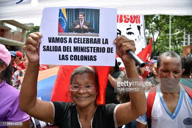 TOPSHOT Supporters of Venezuelan President Nicolas Maduro take part in a demonstration called by the presidency to celebrate Venezuela's official...