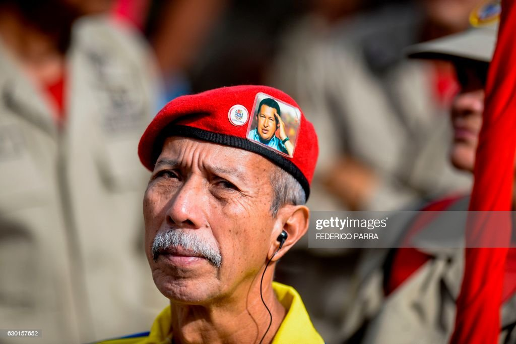 TOPSHOT - Supporters of Venezuelan President Nicolas Maduro take part in a rally to commemorate the anniversary of the death of Liberator Simon Bolivar, in Caracas on December 17, 2016. /