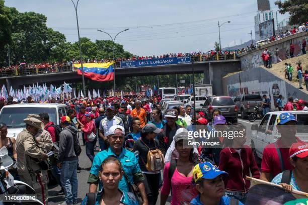 Supporters of Venezuelan President Nicolás Maduro arrive to a demonstration on May 1 2019 in Caracas Venezuela Yesterday Venezuelan opposition leader...