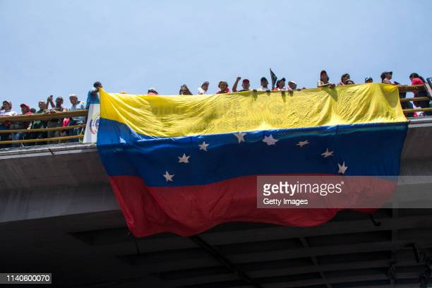 Supporters of Venezuelan President Nicolás Maduro display a flag of Venezuela during a demonstration on May 1 2019 in Caracas Venezuela Yesterday...