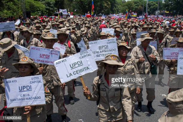 Supporters of Venezuelan President Nicolás Maduro hold banners during a demonstration on May 1 2019 in Caracas Venezuela Yesterday Venezuelan...