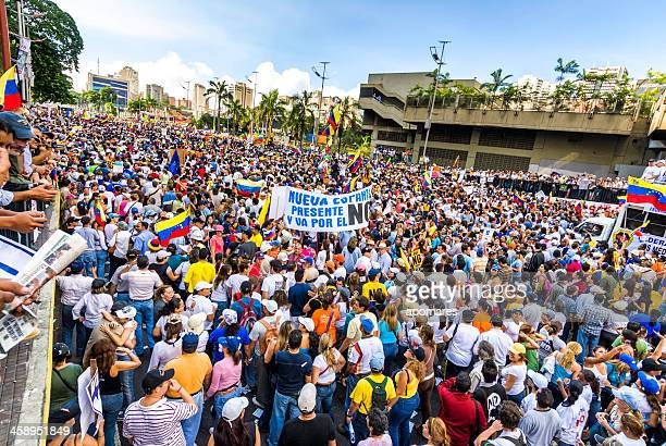 supporters of venezuelan presidential candidate enrique capriles radonski in parade - caracas stock pictures, royalty-free photos & images