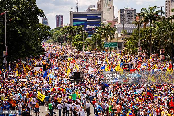 supporters of venezuelan presidential candidate enrique capriles radonski in parade - venezuela stock pictures, royalty-free photos & images