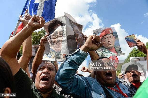 Supporters of Venezuela's late President Hugo Chavez and current President Nicolas Maduro accompany United Socialist Party deputies outside the...