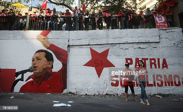 Supporters of Venezuela's President Hugo Chavez attend a rally supporting a referendum on changes to the Constitution introduced by Chavez November...