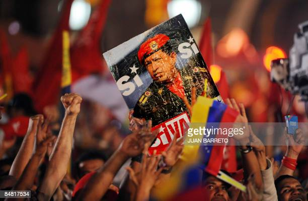 Supporters of Venezuela's President Hugo Chavez celebrate his victory from the balcony of the Presidencial Palace in a referendum on constitutional...