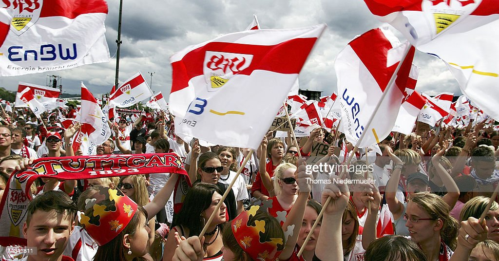 Supporters of VfB Stuttgart cheers during the arriavl of the team at the Stuttgart Fan Mile at the Cannstatter Wasen on May 27, 2007 in Stuttgart, Germany. Thousands of fans appeared to greet the team the day after they won the 2rd place DFB Cup 2007 match in Berlin.