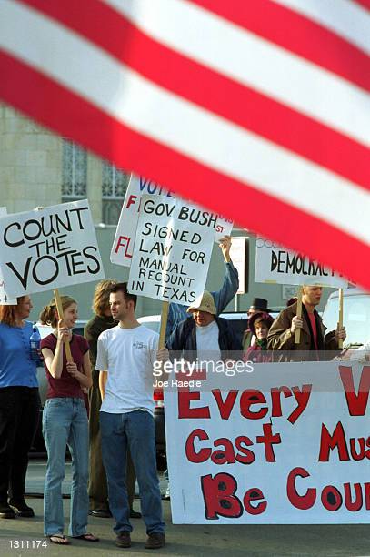 Supporters of Vice President Al Gore hold signs December 10 2000 in front of the Governors mansion in Austin Texas The demonstrators were expressing...