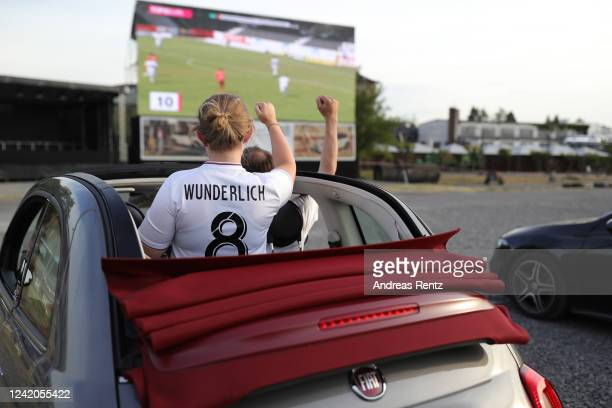 Supporters of Viktoria Koeln watching from their cars the 3. Liga match between FC Viktoria Koeln and FSV Zwickau at drive-in Autokino Car Watch...