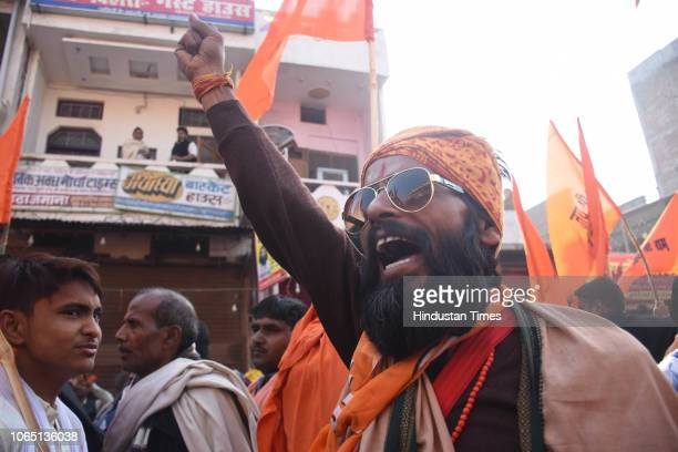 Supporters of Vishwa Hindu Parishad and other Hindu organisaions reach to attend Dharm Sabha amid tight security on November 24 2018 in Ayodhya India...