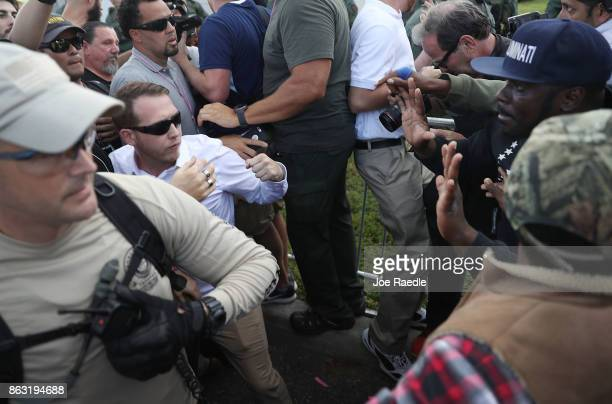Supporters of white nationalist Richard Spencer who popularized the term ÔaltrightÕ clash with people protesting against him after his speech at the...