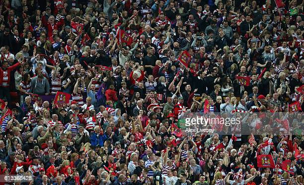Supporters of Wigan Warriors celebrate a try during the First Utility Super League Final between Warrington Wolves and Wigan Warriors at Old Trafford...