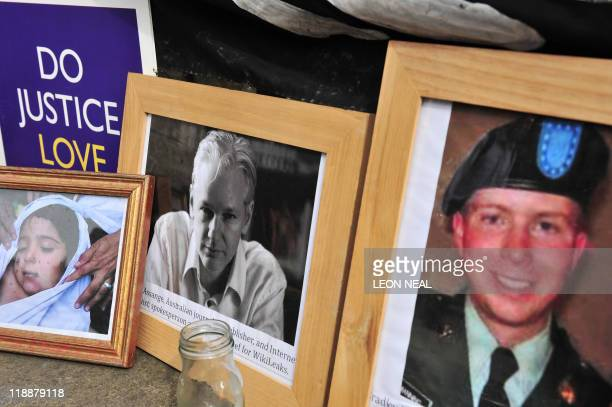 Supporters of Wikileaks founder Julian Assange display photographs of Assange and US serviceman Bradley Manning outside the High Court in central...