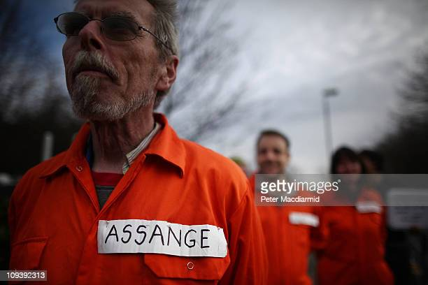 Supporters of Wikileaks founder Julian Assange dressed in Guantanamo Bay prison camp uniforms stand outside Belmarsh Magistrates' Court on February...