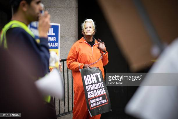 Supporters of Wikileaks founder Julian Assange gather outside the Old Bailey as he appears in court at the resumption of his extradition trial...