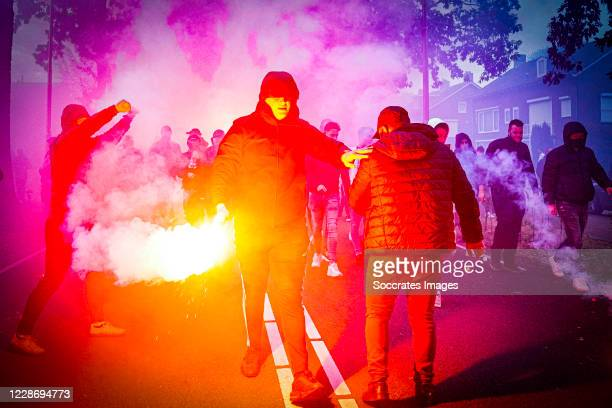 Supporters of Willem II welcomes the players bus arriving at the stadium of Willem II with fireworks during the UEFA Europa League match between...