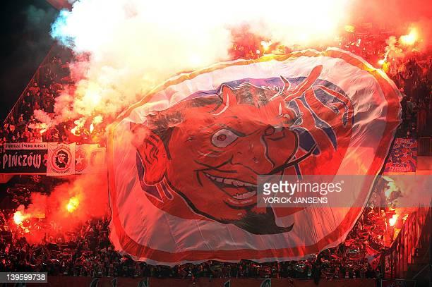Supporters of Wilsa Krakow unfurl a huge banner during an UEFA Europa League round of 32 football match between Standard de Liege and Wisla Krakow on...