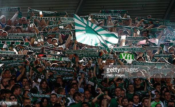 Supporters of Wolfsburg celebrate during the Bundesliga match between Hannover 96 and VfL Wolfsburg at the AWD Arena on May 16 2009 in Hanover Germany