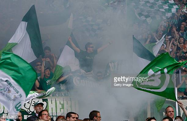 Supporters of Wolfsburg celebrate prior the Bundesliga match between Hannover 96 and VfL Wolfsburg at the AWD Arena on May 16 2009 in Hanover Germany