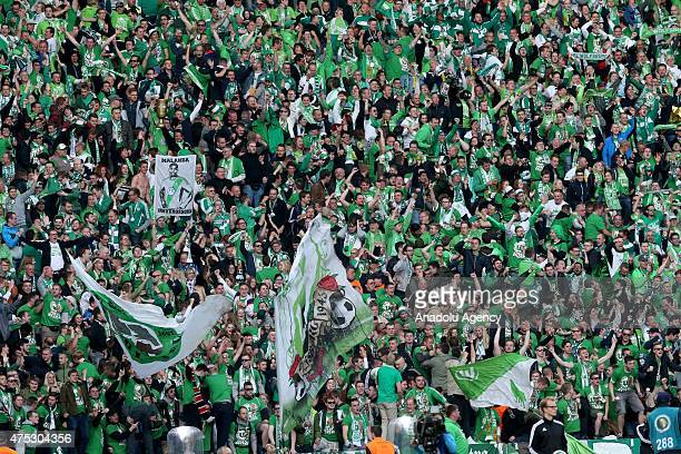 Supporters of Wolfsburg cheer up during the DFB Cup Final match between Borussia Dortmund and VfL Wolfsburg at Olympiastadion on May 30 2015 in...