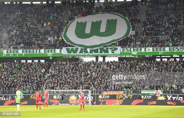Supporters of Wolfsburg display a huge crest banner during the Bundesliga match between VfL Wolfsburg and FC Bayern Muenchen at Volkswagen Arena on...