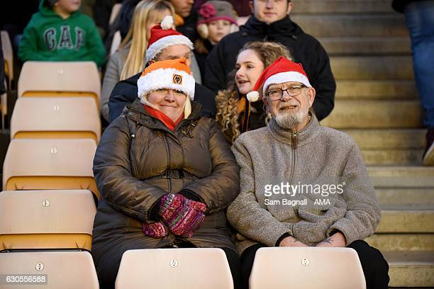 Supporters of Wolverhampton Wanderers in Christmas Santa hats on Boxing Day during the Sky Bet Championship match between Wolverhampton Wanderers and...
